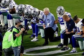 Cowboys take a knee